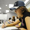 Globe/T. Rob Brown<br /> Ciara Gibson, of Colorado Springs, Colo., a junior early childhood education major who attends both MSSU and OCC, takes notes during a voter registration meeting sponsored by JoAnna Derfelt, MSSU assistant professor of political science, Wednesday afternoon, Sept. 5, 2012, at MSSU's Webster Hall.
