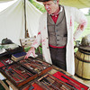 Globe/Emily Younker <br /> Re-enactor Doug Kidd shows off the medical equipment he would have used as a doctor during the Civil War during a celebration of the 150th anniversary of the battle of Newtonia on Saturday. Kidd, in portraying a surgeon living locally, said he likely would have been forced by the troops to treat wounded soldiers from both the Confederate and Union armies following the battle.