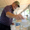 Globe/Roger Nomer<br /> Daniel Stevenson, Fort Worth, Texas, put in an entry for a canning drawing at the Webb City Farmers Market on Tuesday.