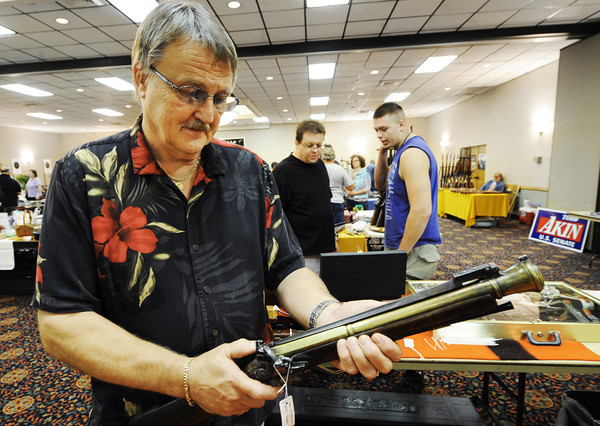Globe/T. Rob Brown<br /> Jack Davis, an antique firearms collector, operates the extracting bayonet portion of a post-Revolutionary War (circa 1790 or older) boarding blunderbuss during the White Buffalo Traders Gun Show Saturday afternoon, Sept. 15, 2012, at Joplin's Holiday Inn.