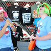 Globe/T. Rob Brown<br /> Webb City High School freshmen Kevin Hinojoza (left), baritone player, and Zac Barbee, bass clarinet player, have fun as they try to entice customers to purchase wigs and inflatable instruments for the Webb City Band Boosters booth during the eighth annual Webbstock marching festival Saturday, Sept. 22, 2012, at Webb City's Cardinal Stadium.