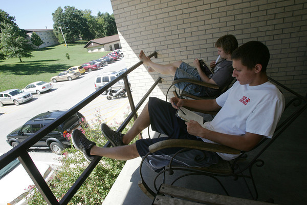 Globe/Roger Nomer<br /> Ozark Christian College students Keith Graves, a junior from Oklahoma City, left, and Cameron Woodring, a freshman from Ft. Scott, study on the porch of their dorm on Monday afternoon.