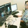 Globe/Roger Nomer<br /> Melissa Bay looks at a mammography image at Mercy's new Breast Cancer Center on Friday afternoon.