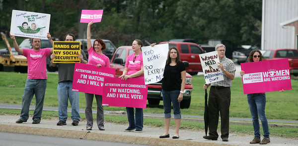 Globe/Roger Nomer<br /> Protestors gather across the street from the Jasper County Republican Headquarters during Rep. Todd Akin's visit on Wednesday.