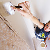 Globe/T. Rob Brown<br /> Dana Wall, MSSU budgeting and procurement clerk, volunteers to paint walls inside a Joplin Area Habitat for Humanity house in the 2500 block of Picher Avenue as part of Patriot Day and National Day of Service and Remembrance Tuesday, Sept. 11, 2012.