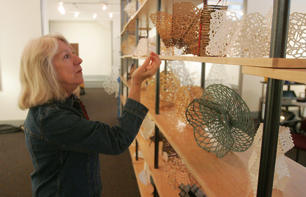 Globe/Roger Nomer<br /> Linda Fleming talks about her models for sculptures during an interview at Spiva on Wednesday.