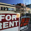 Globe/Roger Nomer<br /> For rent and sale signs dot the landscape in downtown Joplin.