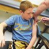Globe/Roger Nomer<br /> Matthew Knoderer-Moore, 8, Webb City, tries to keep a brave face while getting a flu shot at the Joplin Health Department on Monday.