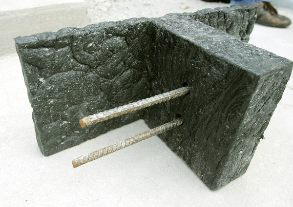 Globe/Roger Nomer<br /> An example shows how rebar is fitted through plastic blocks in the shelter.  Concrete is then poured around the rebar for the finished shelter.