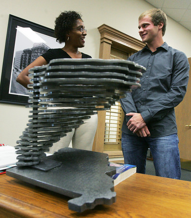 Globe/Roger Nomer<br /> Joplin Mayor Melodee Colbert-Kean talks with Sawyer Brown about his sculpture following Thursday's presentation at Joplin City Hall.