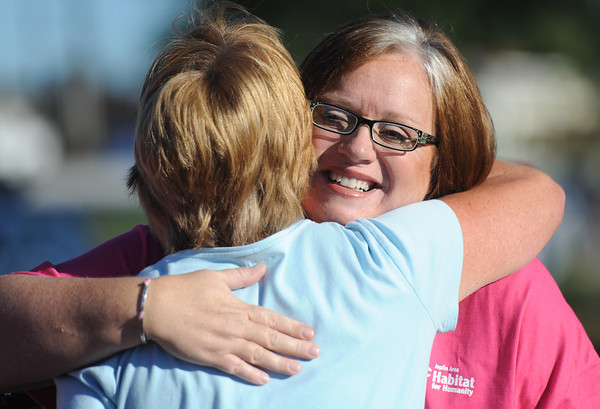 Globe/T. Rob Brown<br /> Stephanie Roper, of Joplin, gets a hug from a friend Saturday morning, Sept. 8, 2012, following the ground-breaking ceremony for her Joplin Area Habitat for Humanity home in the 2300 block of Empire Avenue.