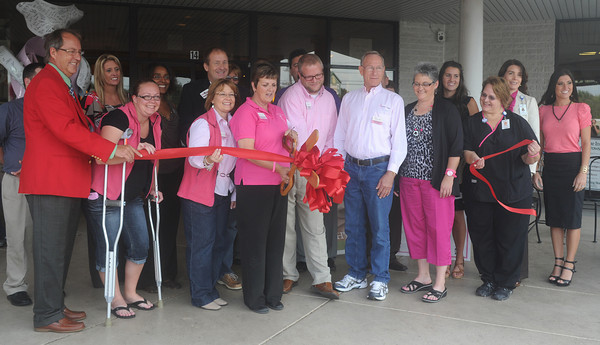 Globe/Roger Nomer<br /> The ribbon is cut to mark the start of sales of pink ribbon bagels at Panera Bread on Monday morning.  Oct. 12th is Sarah Burkybile day at the restaurant, where 100% of the proceeds from the sale of the bagels will go to Hope 4 You.