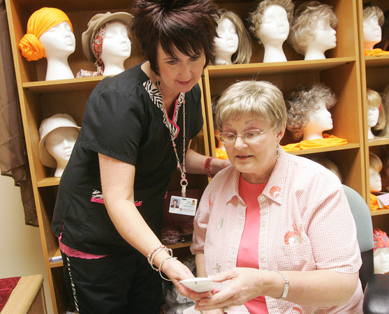 Globe/Roger Nomer<br /> Lisa Nelson, left, shows Kathy McDonald makeup as part of the Look Good Feel Better program at Freeman.