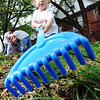 Globe/T. Rob Brown<br /> Katie Chew, 3, of Seneca, daughter of Shauna Chew, rakes the leaves out of a yard near the intersection of A Street and Wall Avenue Sunday morning, Sept. 30, 2012, during the Great Day of Service in Joplin.
