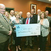 Globe/Roger Nomer<br /> (from left) Rep. Bill Lant, Sheila Kersey, Rob Brown, Margaret Nollsch, director of Care Net Preganancy Resource, Randall Kraft, Rep. Bill Reibolt, Rocky Swearingen, Robert Kissel, president of the National Association of Insurance and Financial Advisors-Southwest Missouri Chapter, Linda Teeter, vice president of NAIFA, Wayn Blackford and Linda Hathaway present a check for $500 to Care Net during the chapter's meeting on Tuesday at Pitchers Sports Bar and Grill.