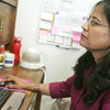 Globe/Roger Nomer<br /> Anisa Hassan looks at a patient's information in her office at the Freeman Cancer Institute on Thursday.
