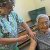 Globe/Roger Nomer<br /> Jan Clark, a RN at the Joplin Health Department, gives a flu shot to Hortencia Rivera, Joplin, on Monday morning.