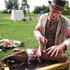 Globe/Emily Younker <br /> Re-enactor Doug Kidd, portraying a Civil War-era doctor, demonstrates a surgery he might have performed on a wounded soldier's arm. Kidd had an authentic 1860s field hospital tent set up Saturday at the Ritchey Mansion in Newtonia, which was celebrating the 150th anniversary of the Civil War battle that took place there.