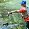 Russell Watts, of Rogers, Ark., casts his line as he fishes for trout on Tuesday at Roaring River State Park. Watts said each year for his birthday, he spends three days fishing at Roaring River.<br /> Globe | Laurie Sisk
