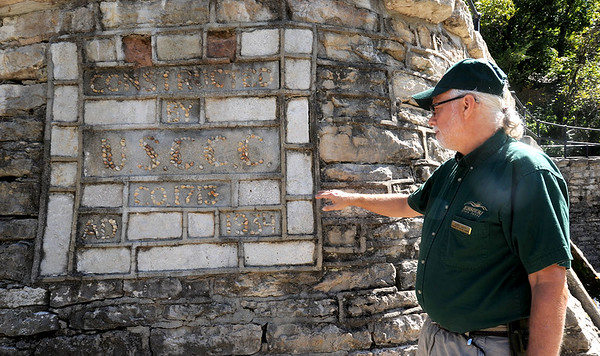Kerry Hayes, Missouri Department of Natural Resources Park Manager at Roaring River State Park, stands near a stone marker that serves as a tribute the Civilian Conservation Corp. Hayes said CCC workers used stone quarried at the site to build most of the features at the park.<br /> Globe | Laurie Sisk