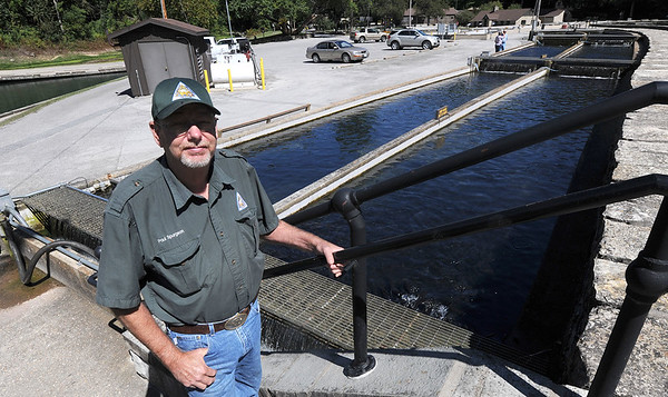 Paul Spurgeon, hatchery manager for the Missouri Department of Conservation stands near a raceway for trout at the fish hatchery at Roaring River State Park on Tuesday. Spurgeon said the park is stocked with about 250,000 trout annually.<br /> Globe   Laurie Sisk