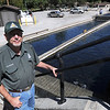 Paul Spurgeon, hatchery manager for the Missouri Department of Conservation stands near a raceway for trout at the fish hatchery at Roaring River State Park on Tuesday. Spurgeon said the park is stocked with about 250,000 trout annually.<br /> Globe | Laurie Sisk