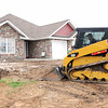 Crews level the yard on Wednesday at a new home being built by Allphin Construction at 2129 Delaware.<br /> Globe   Laurie Sisk