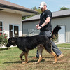 Globe/Roger Nomer<br /> Justin Renn walks Slyvan on Friday at the Joplin Humane Society.