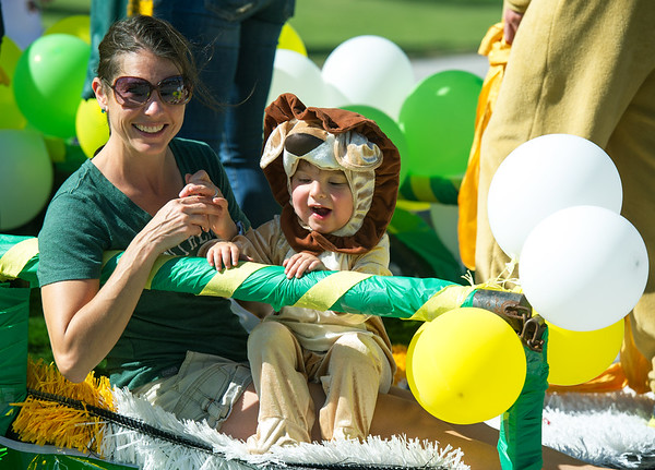 Andrea and two-year-old Asher Cullers represent the Missouri Southern Kinesiology Department during the 2017 MSSU Homecoming Parade on Saturday at MSSU.<br /> Globe   Laurie Sisk