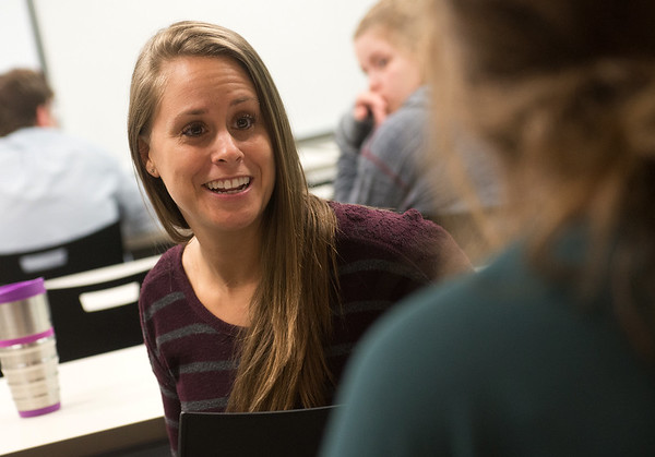 Globe/Roger Nomer<br /> Danita Tamilio talks with a classmate before her world religions class at Crowder College Webb City campus on Wednesday.