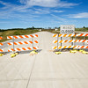 Signs mark the end of current construction on the I-49 Bypass project leading into Missouri on Thursday.<br /> Globe | Laurie Sisk