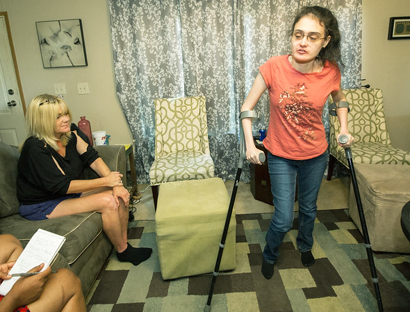 Shanda York, left, talks about the risk of having to go to a nursing home at the age of 23 should state cuts to in-home care funding happen. Left is Shanda's mother and primary caregiver, Angela York. Shanda has spina bifida and hydrocephalus.<br /> Globe | Laurie Sisk
