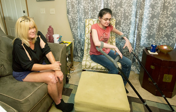 Shanda York, left, talks about the danger of having to go to a nursing home at the age of 23 should state cuts to in-home care funding happen. Left is Shanda's mother and primary caregiver, Angela York. Shanda has spina bifida and hydrocephalus.<br /> Globe | Laurie Sisk