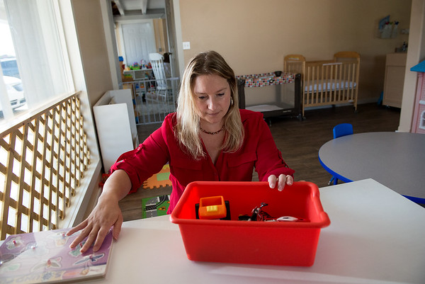 Globe/Roger Nomer<br /> Christine Baird, owner of Footprints and Friends Preschool, prepares a classroom at the school on Wednesday.