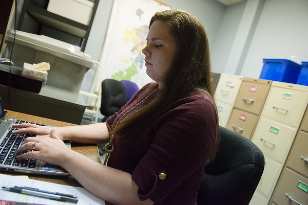 Globe/Roger Nomer<br /> Natasha Keppen logs a report as an intern with the Carthage Municipal Court on Tuesday at Carthage City Hall.