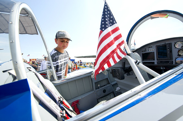 Seven-year-old Macer McCoy checks out the cabin of a Van's RV-8 built by Bill and Brenda Crissinger during Alpha AirFest 2017 on Saturday at the Joplin Regional Airport. The show continues today with a full slate of activities from 10 a.m. to 5 p.m. It took about 2,200 hours over four years to build the plane.<br /> Globe | Laurie Sisk
