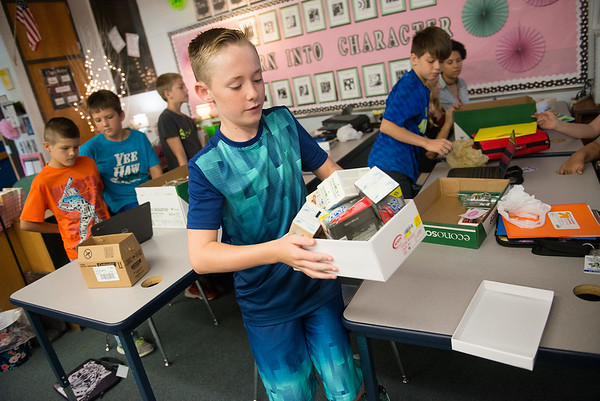Globe/Roger Nomer<br /> Dillon Leggett, Riverton Middle School sixth grader, helps collect donations to Texas hurricane victims on Thursday at the school.