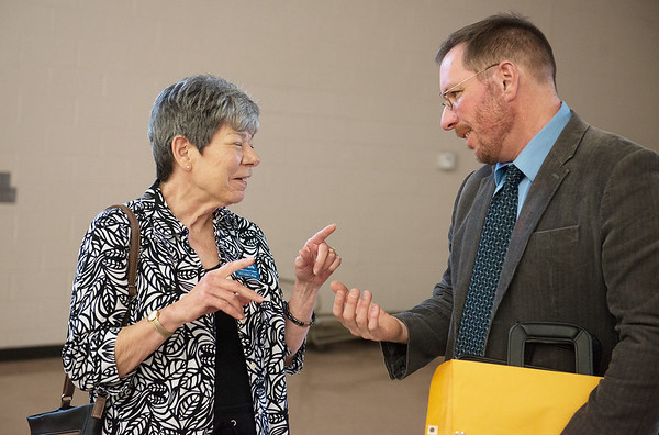 Globe/Roger Nomer<br /> Linda Fracek talks with Andrew Carroll following his presentation on Monday at the Grove Community Center. Fracek is the assistant director of Carroll's play being produced in Grove and the coach of the actor playing Carroll in the play.