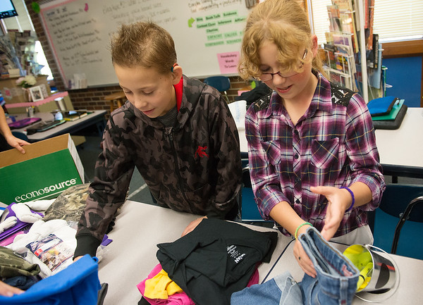 Globe/Roger Nomer<br /> Alex Moss and Alysha Thompson, Riverton Middle School sixth graders, sort clothing for donations to Texas hurricane victims on Thursday at the school.