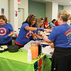 Photo Courtesy of Freeman Health System<br /> Allison Andrasko, Celina Mercado and Mayra Ramirez from medical oncology serve carnitas on Friday as part of annual Freeman Donor Council Cooking Café. Several Freeman departments cooked items to benefit the Freeman Donor Council, which honors donors and raises awareness about the importance of organ, eye and tissue donation.