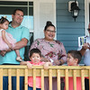 Globe/Roger Nomer<br /> Dalton and Darlyn Morris celebrate their new home with children Rebekah, 1, Joseph, 3, and David, 5, and Joplin Salvation Army Major Doug Stearns on Friday in Joplin. Habitat for Humanity partnered with the Joplin Salvation Army on the home.