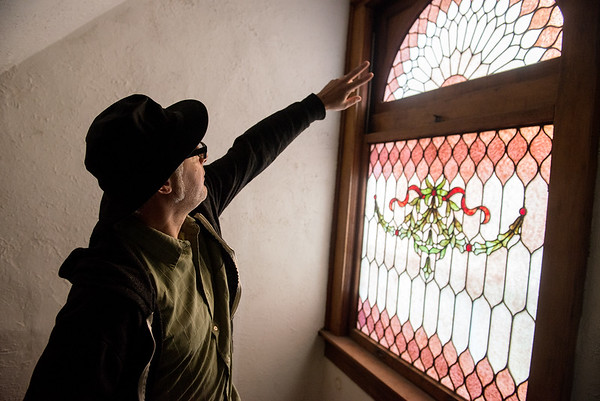 Globe/Roger Nomer<br /> Michael Englebert Griffin talks about a stained glass window in the Rogers House during a tour on Wednesday.