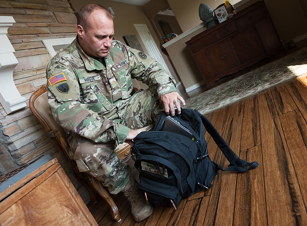 Globe/Roger Nomer<br /> Marshall Hogue packs for a trip to Fort Leonard Wood on Friday at his home in Joplin.