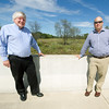 From the left: Jeff Hawkins, executive director of the Northwest Arkansas Regional Planning Commission and Tim Conklin, transportation program manager for NWARPC, stand Thursday on a bridge near Bentonville on County Road 34, where a continuation of the I-49 Bypass project into Missouri is planned.<br /> Globe | Laurie Sisk