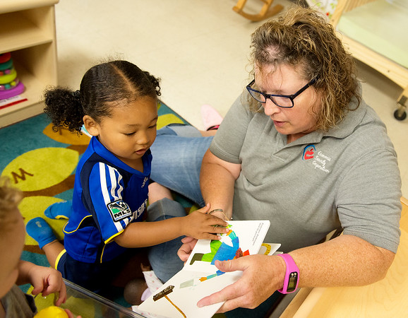 Globe/Roger Nomer<br /> Suzanne Glisson, teacher's aide, reads with Makio Warren, 2, on Wednesday at the Early Childhood Center in Joplin.
