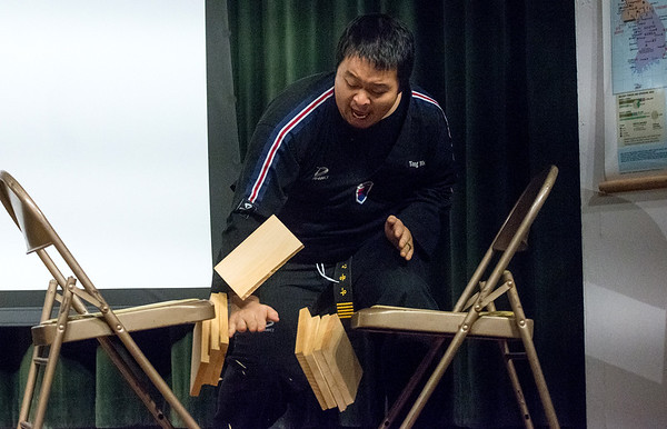 Globe/Roger Nomer<br /> Yong Woo Kang breaks a pile of boards during Wednesday's Taekwondo demonstration at Missouri Southern as part of the university's Korea Semester.