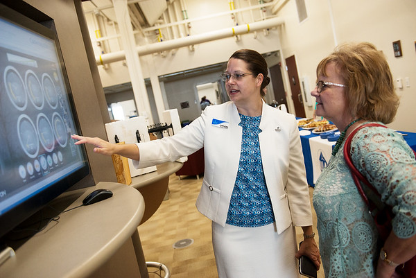 Globe/Roger Nomer<br /> Melissa Oates, director of the Roy Blunt Center for Missouri Alternative and Renewable Energy Technology, gives a tour to Jan Schumacher, program manager for Missouri Energy Initiative, left, on Friday at Crowder College.