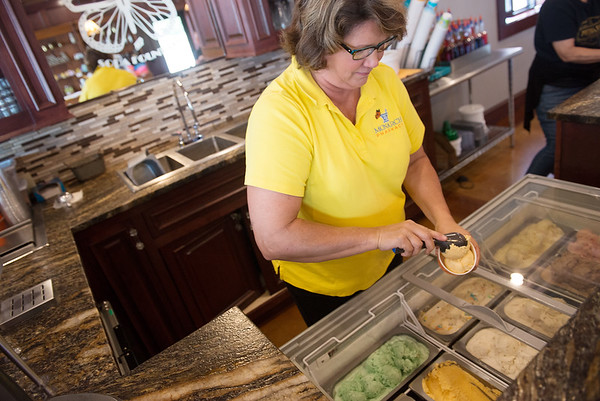 Globe/Roger Nomer<br /> Kelly St. Clair-Barnes scoops ice cream on Tuesday at the Monarch Pharmacy in Baxter Springs.