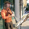 Clarinetist Ron Erwin entertains guests at the First Thursday Artwalk outside his studio, Erwin Photography, on Main street on Thursday night.<br /> Globe | Laurie Sisk
