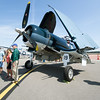 Guests check out a Marine Corps FG1 Corsair, on display courtesy of the Cavanaugh Flight Museum, during Alpha AirFest 2017 on Saturday at the Joplin Regional Airport. The collapsable wings provide for more storage space on aircraft carriers. The show continues today with a full slate of activities from 10 a.m. to 5 p.m.<br /> Globe | Laurie Sisk